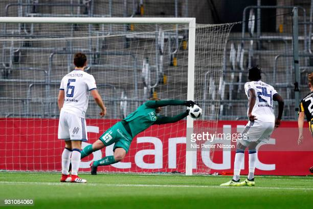 Peter Abrahamsson of BK Hacken makes a save on a shot from Tinotenda Kadewere of Djurgardens IF during the Swedish Cup Quarterfinal between...