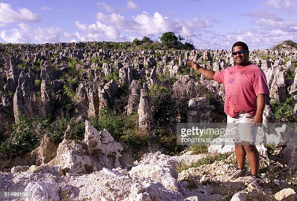 Peter Akubor shows off the moonscape of limestone pinnacles in Nauru 11 September 2001 where the 521 mainly Afghan refugees who have been refused...