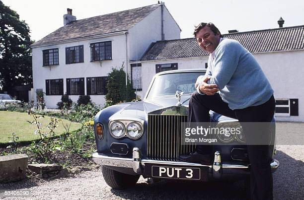 Peter Alliss relaxes by his Rolls Royce, outside his home.