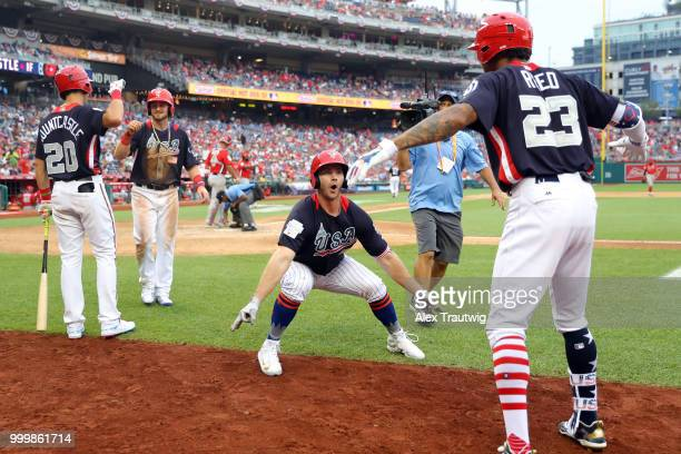 Peter Alonso of Team USA is greeted by Buddy Reed after hitting a tworun home run in the seventh inning during the SiriusXM AllStar Futures Game at...