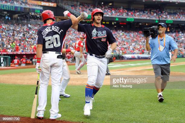 Peter Alonso of Team USA is greeted by Ryan Mountcastle after hitting a tworun home run in the seventh inning during the SiriusXM AllStar Futures...