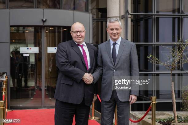 Peter Altmaier Germanys acting finance minister left poses for a photograph with Bruno Le Maire Frances finance minister ahead of a news conference...