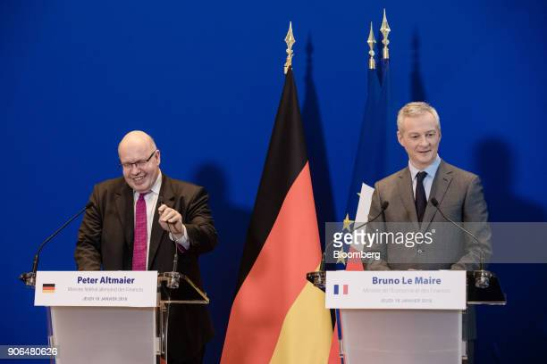Peter Altmaier Germanys acting finance minister left reacts as he stands beside Bruno Le Maire Frances finance minister during a news conference at...