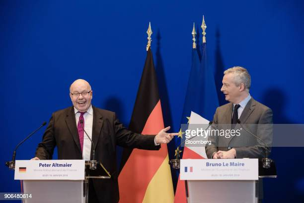 Peter Altmaier Germanys acting finance minister left reacts while gesturing towards Bruno Le Maire Frances finance minister during a news conference...