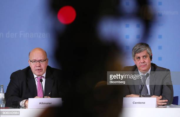 Peter Altmaier, Germanys acting finance minister, left, speaks as he sits beside Mario Centeno, Portugal's finance minister and head of the group of...