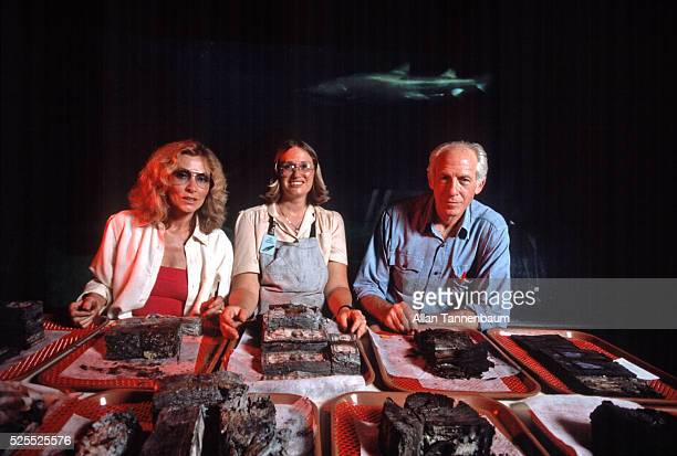 Peter and Elga Gimbel with a technician and the contents of the purser's safe of the Andrea Doria New York New York August 17 1984