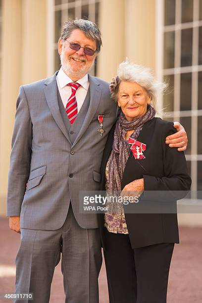 Peter and Joan Rhodes pose with their MBE medals awarded during an investiture ceremony at Buckingham Palace on October 9 2014 in London England