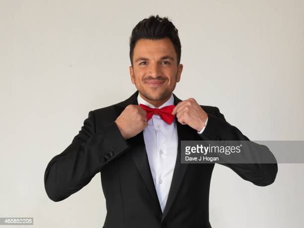 Peter Andre adjusts his bow tie on the set of his new video 'Kid' the UK's Official track for the new DreamWorks Animation 'Mr Peabody Sherman' in...