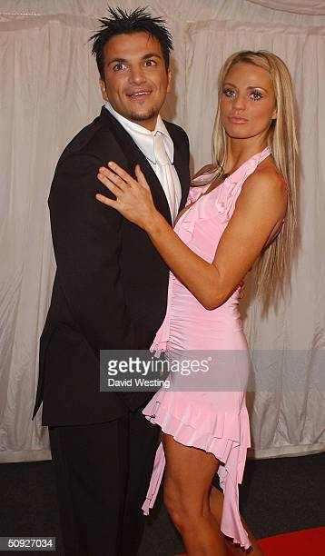Peter Andre and Jordan arrive for the penultimate day of filming of television program 'Hell's Kitchen' at Brick Lane on June 4 2004 in London Hell's...