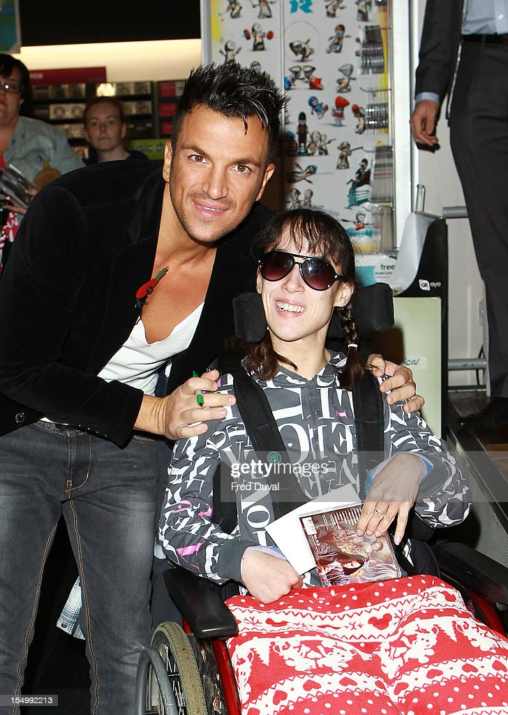 Peter Andre meets fans and signs copies of his album 'Angels & Demons' at HMV, Oxford Street on October 30, 2012 in London, England.