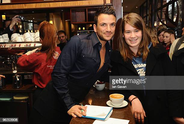 Peter Andre promotes Costa Flat White coffee with a customer at a Costa coffee shop in Piccadilly on January 27 2010 in London England