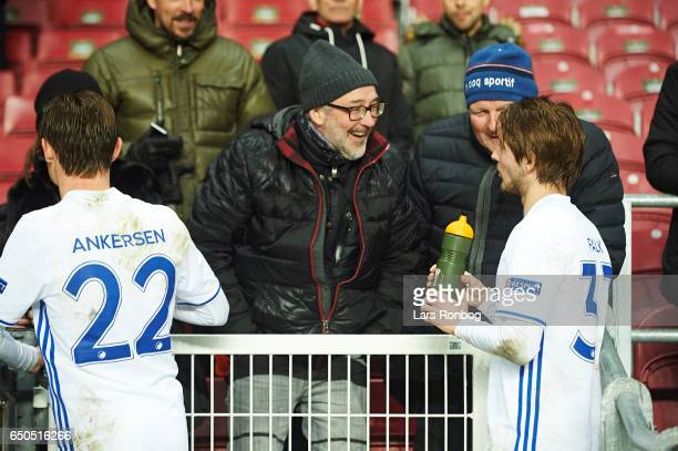 Peter Ankersen and Rasmus Falk of FC Copenhagen speaks to friends and family after the UEFA Europa League Round of 16 First Leg match between FC...