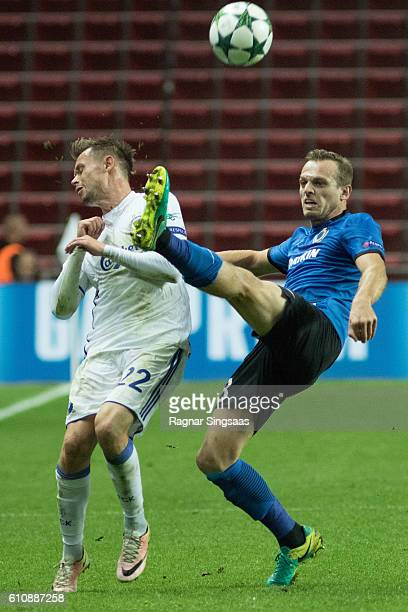 Peter Ankersen of FC Copenhagen and Laurens De Bock of Club Brugge KV compete for the ball during the UEFA Champions League match between FC...