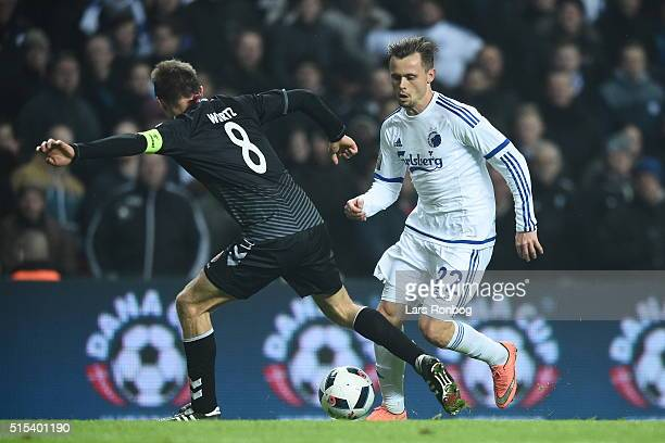 Peter Ankersen of FC Copenhagen and Rasmus Wurtz of AaB Aalborg compete for the ball during the Danish Alka Superliga match between FC Copenhagen and...