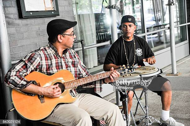 Peter Archer and Jose Rodriguez perform during Make Music Day Uptown Funk/Street Studio Harlem at Mist Harlem on June 21 2016 in New York City