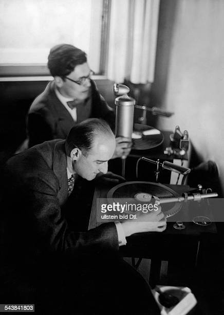 Peter Arco and Hans Hellhoff during the recording of a radio feature Photographer Ullmann Published by 'Hier Berlin' 22/1937Vintage property of...