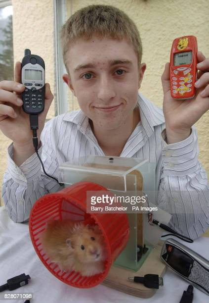 Peter Ash 16 with his hamster powered mobile phone charged 'Elvis' at his home in Lawford Somerset Thursday August 25 2005 See PA Story Peter Ash...