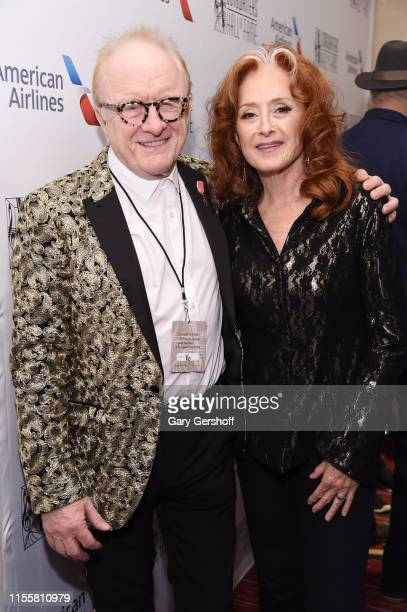 Peter Asher and Bonnie Raitt pose backstage during the Songwriters Hall Of Fame 50th Annual Induction And Awards Dinner at The New York Marriott...