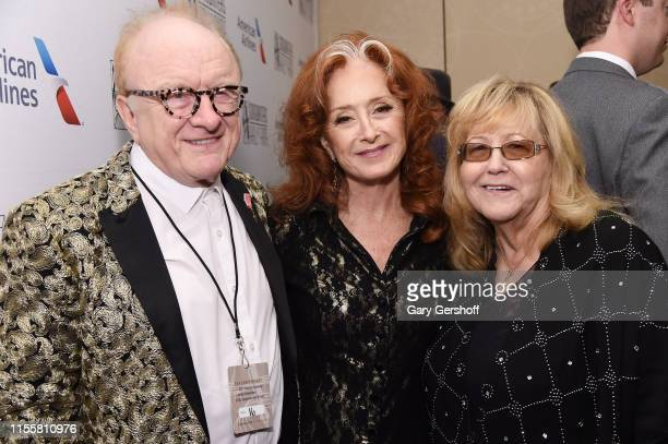 Peter Asher Bonnie Raitt Linda Moran pose backstage during the Songwriters Hall Of Fame 50th Annual Induction And Awards Dinner at The New York...