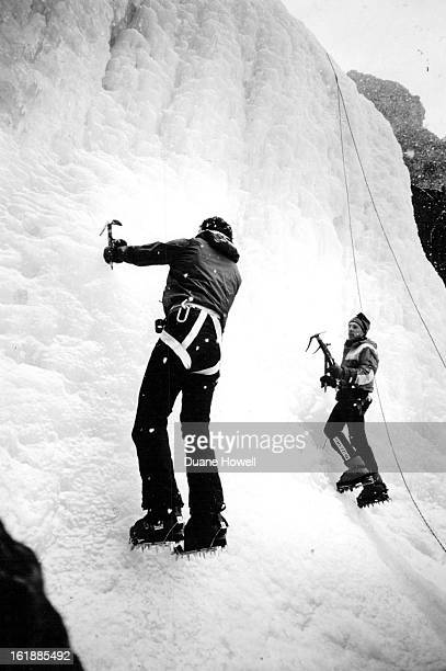 2211988 Peter Athans left and Stev Matous climb an ice waterfall in Clear Creek Canyon in preparation for their assault of K2 the second highest...