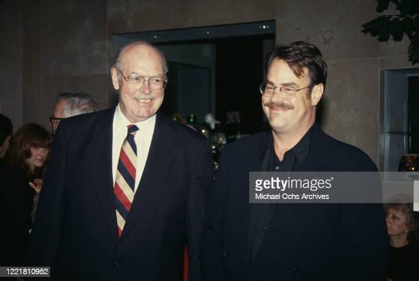 Peter Aykroyd with his son, Canadian actor and comedian Dan Aykroyd at an unspecified event, 1993.