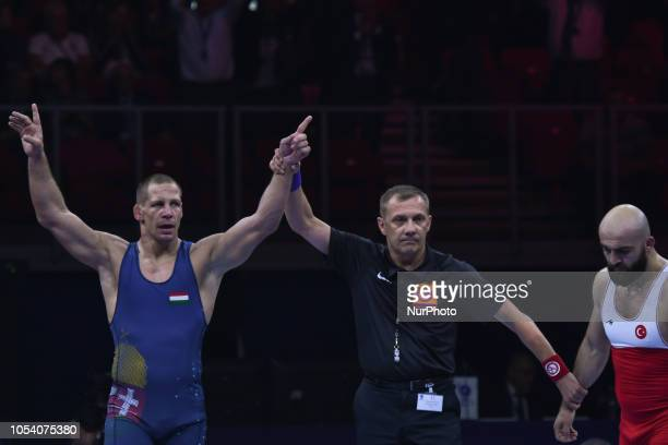 Peter Bacsi of Hungry wins against Emrah Kus of Turkey a final in men's GreecoRoman wrestling 82kg category at the World Wrestling Championships in...