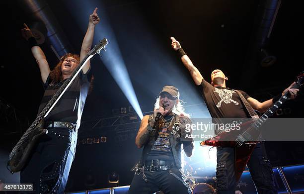 Peter Baltes Mark Tornillo and Wolf Hoffmann of German heavy metal band Accept perform during a concert at Huxleys Neue Welt on October 21 2014 in...