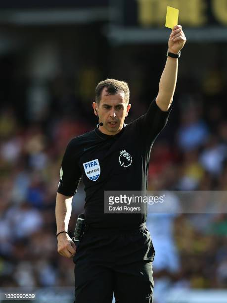Peter Bankes, the referee shows a yellow card during the Premier League match between Watford and Wolverhampton Wanderers at Vicarage Road on...