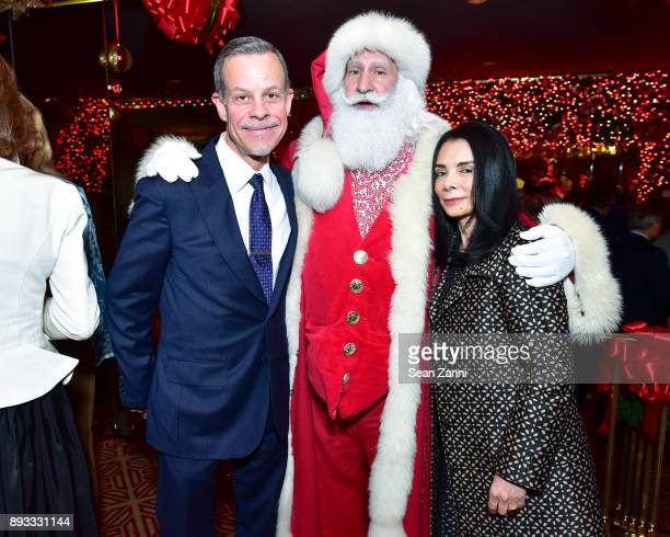 Peter Barba Santa Claus and Mary Boone attend A Christmas Cheer Holiday Party 2017 Hosted by George Farias and Anne and Jay McInerney at The Doubles...