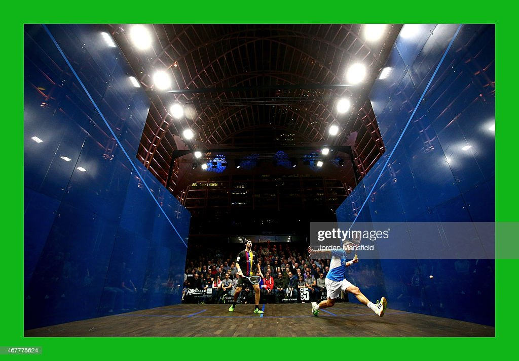 Peter Barker of Great Britain (R) plays a shot during his semi-final match against Simon Rosner of Germany (L) during Day 4 of the Canary Wharf Squash Classic at the East Wintergarden on March 26, 2015 in London, England.