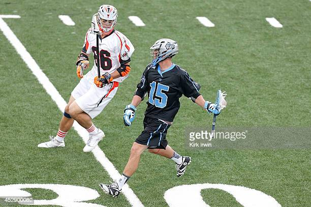 Peter Baum of the Ohio Machine attempts to move the ball past Michael Simon of the Denver Outlaws on July 26 2014 at Selby Stadium in Delaware Ohio...