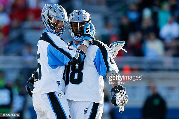 Peter Baum of the Ohio Machine celebrates his goal with teammate Kyle Harrison against the New York Lizards at James M Shuart Stadium on April 12...