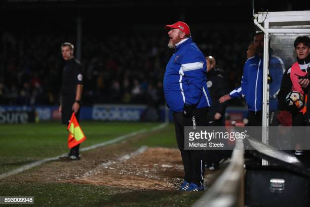 Peter Beadle the manager of Hereford shouts instructions from the bench during the Emirates FA Cup second round replay match between Hereford FC and...