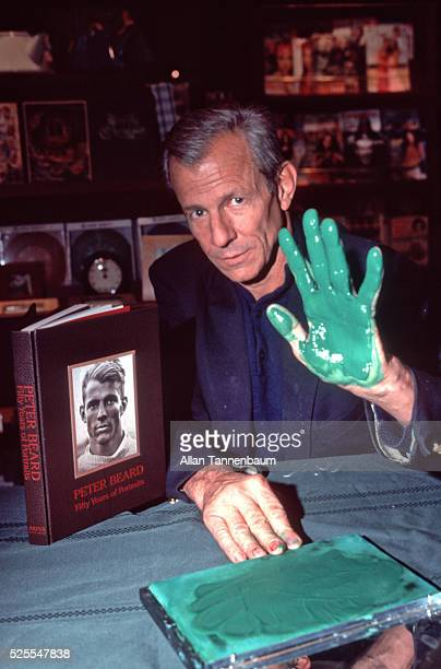 Peter Beard signs his book '50 Years of Portraits' at Rizzoli in SoHo with his hand dipped in green ink New York New York November 30 1999