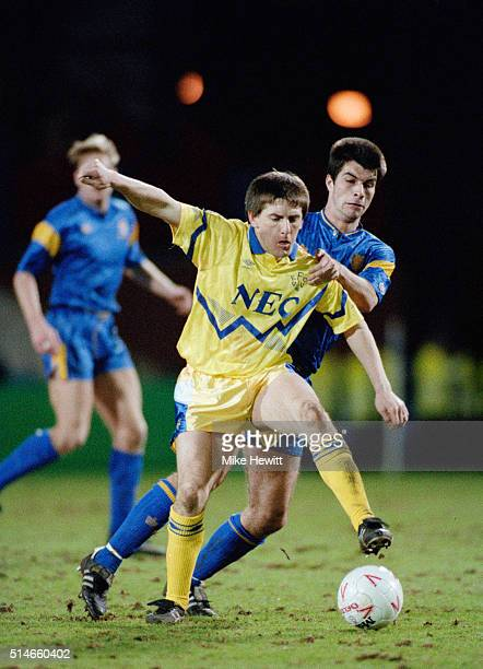 Peter Beardsley of Everton holds off a challenge during a League Division One match between Wimbledon and Everton on March 10 1992 in London England