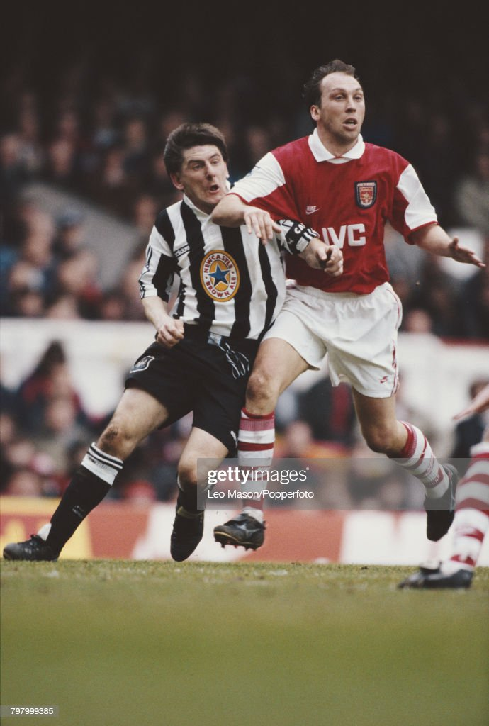 Peter Beardsley of Newcastle (left) and David Platt of Arsenal clash for the ball during the Premier League match between Arsenal and Newcastle United at Highbury stadium in London on 23rd March 1996. Arsenal would go on to win the game 2-0.