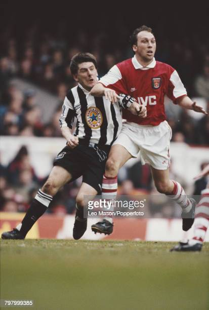 Peter Beardsley of Newcastle and David Platt of Arsenal clash for the ball during the Premier League match between Arsenal and Newcastle United at...