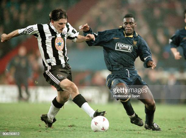 Peter Beardsley of Newcastle United and Robbie Earle of Wimbledon in action during an FA Carling Premiership match at Selhurst Park on December 3...