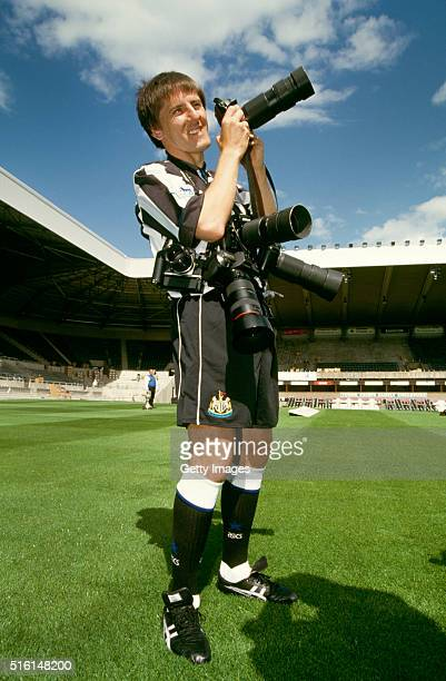 Peter Beardsley pictured with photographers cameras in a set up picture as Beardsley returns to Newcastle United for his second spell with the club...
