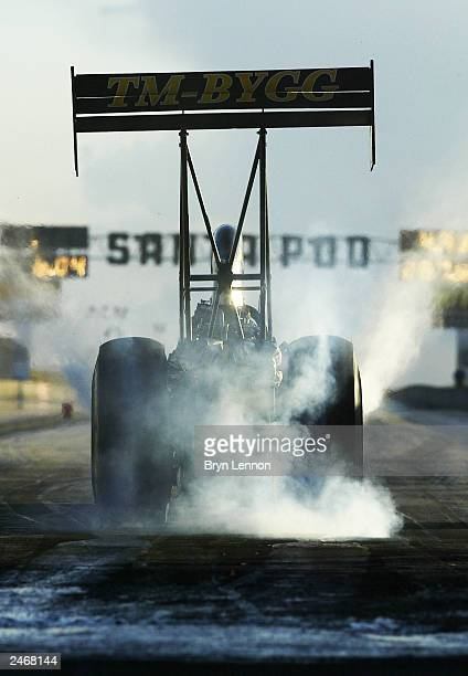 Peter Beck of Switzerland leaves the start line in the Top Fuel event during the FIA European Drag Racing Finals at Santa Pod Raceway on September 6...