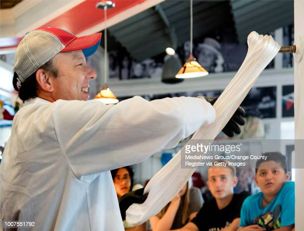 Peter Behringer owner of Sweet PeteÕs gets a workout making hand pulled cherry lollipops at Farrell's in Buena Park on Thurs Aug 17