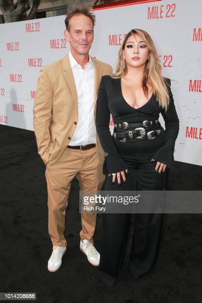 Peter Berg and CL attend the premiere of STX Films' Mile 22 at Westwood Village Theatre on August 9 2018 in Westwood California