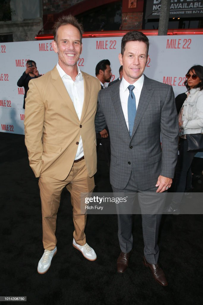 Peter Berg (L) and Mark Wahlberg attend the premiere of STX Films' 'Mile 22' at Westwood Village Theatre on August 9, 2018 in Westwood, California.