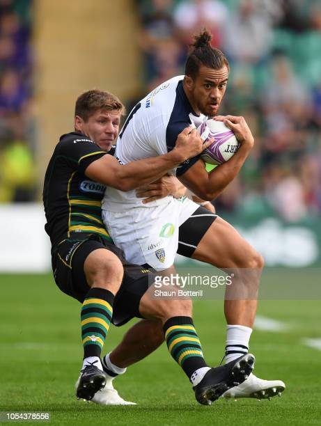 Peter Betham of Clermont Auvergne is tackled by Piers Francis of Northampton Saints during the Challenge Cup match between Northampton Saints and...