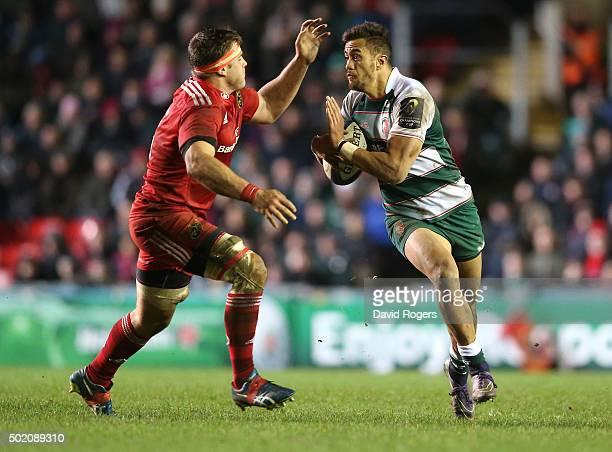 Peter Betham of Leicester holds of CJ Stander during the European Rugby Champions Cup match between Leicester Tigers and Munster at Welford Road on...