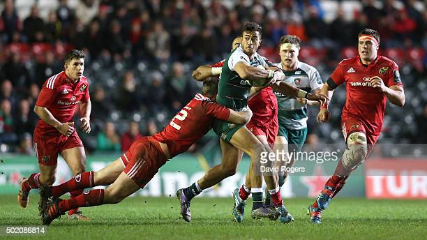 Peter Betham of Leicester is tackled by Denis Hurley and Simon Zebo during the European Rugby Champions Cup match between Leicester Tigers and...