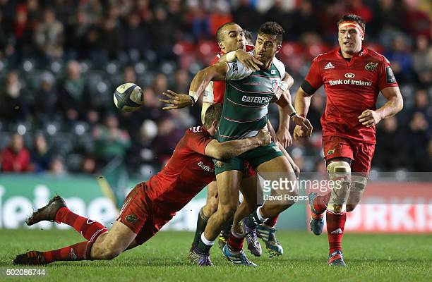 Peter Betham of Leicester off loads the ball as Denis Hurley and Simon Zebo tackle during the European Rugby Champions Cup match between Leicester...