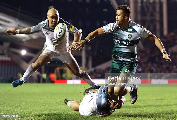 Peter Betham of Leicester offloads the ball during the Aviva Premiership match between Leicester Tigers and Newcastle Falcons at Welford Road on...
