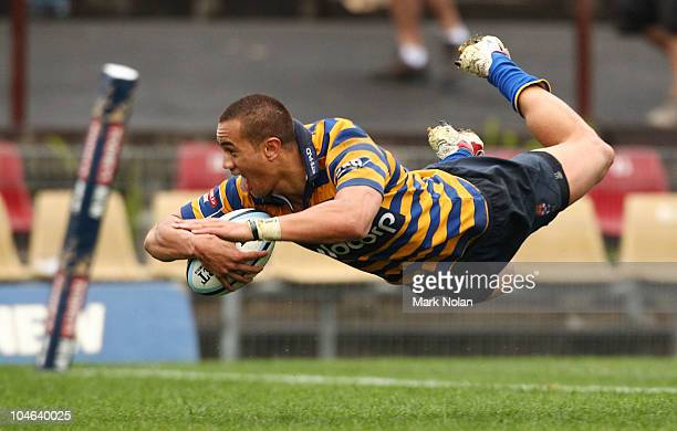 Peter Betham of Sydney Uni dives over for a try during the Shute Shield Grand Final match between Randwick and Sydney University at Concord Oval on...