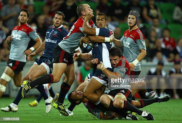 Peter Betham of the Rebels is tackled by Willi Heinz of the Crusaders during the Super Rugby trial match between the Melbourne Rebels and the...